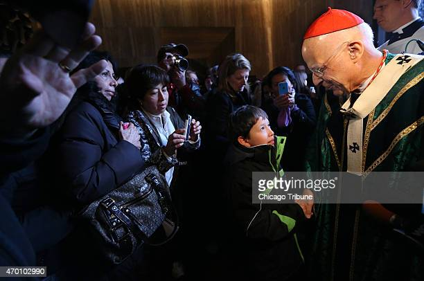 Cardinal Francis George shakes hands with his parishioners at the end of his final mass on Nov 16 2014 at Holy Name Cathetdral in Chicago George has...