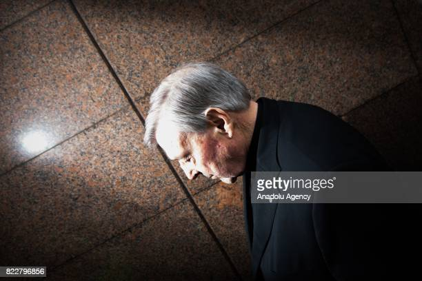 Cardinal George Pell leaves after court hearing at the Melbourne Magistrates Court in Melbourne Australia on July 26 2017 Vaticans finance chief was...
