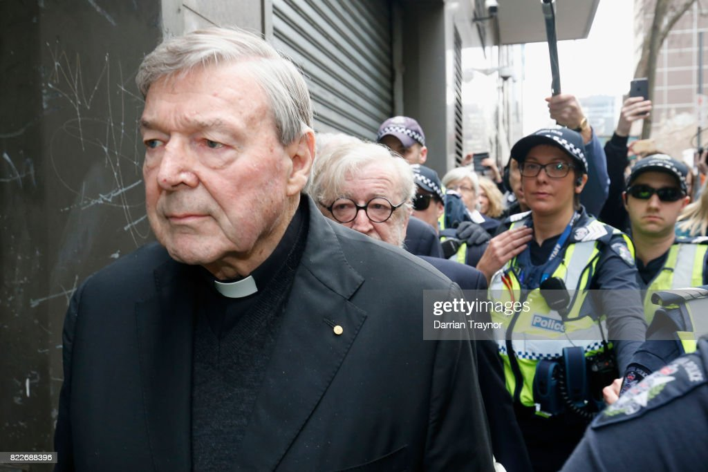 Cardinal George Pell leaves court with a heavy police guard in Melbourne on July 26, 2017 in Melbourne, Australia. Cardinal Pell was charged on summons by Victoria Police on 29 June over multiple allegations of sexual assault. Cardinal Pell is Australia's highest ranking Catholic and the third most senior Catholic at the Vatican, where he was responsible for the church's finances. Cardinal Pell has leave from his Vatican position while he defends the charges.