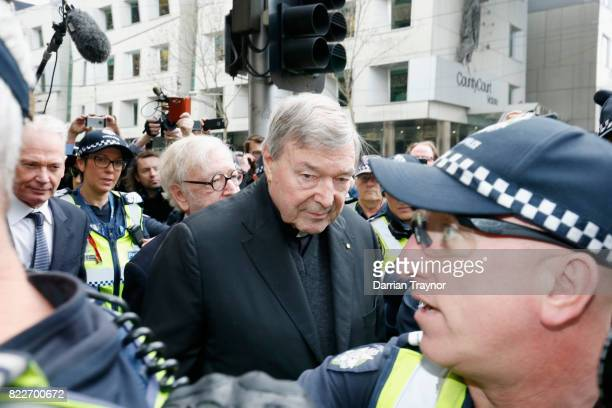 Cardinal George Pell leaves the Melbourne Magistrates Court with a heavy police guard in Melbourne on July 26 2017 in Melbourne Australia Cardinal...