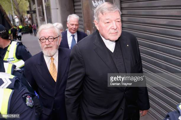 Cardinal George Pell walks from his lawyers office to the Melbourne Magistrates' Court on October 6 2017 in Melbourne Australia Cardinal Pell was...