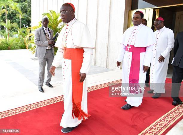 Cardinal JeanPierre Kutwu Monsignor Alexis Touably Youlo and president of Ivory Coast's Bishops Conference Monsignor Ignace Bessi Dogbo leave from an...