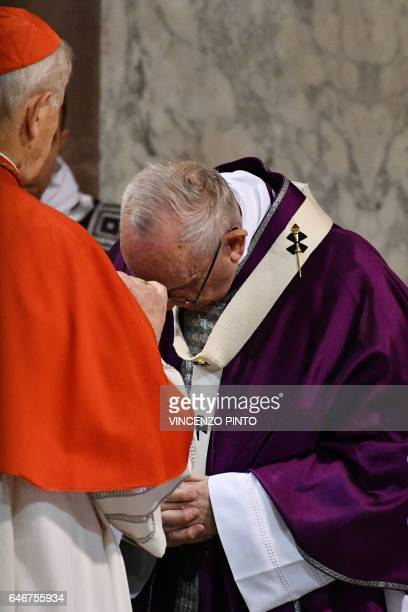 Cardinal Jozef Tomko prepares the sign of the cross with ashes on the forehead of Pope Francis during the Ash Wednesday mass opening Lent the...