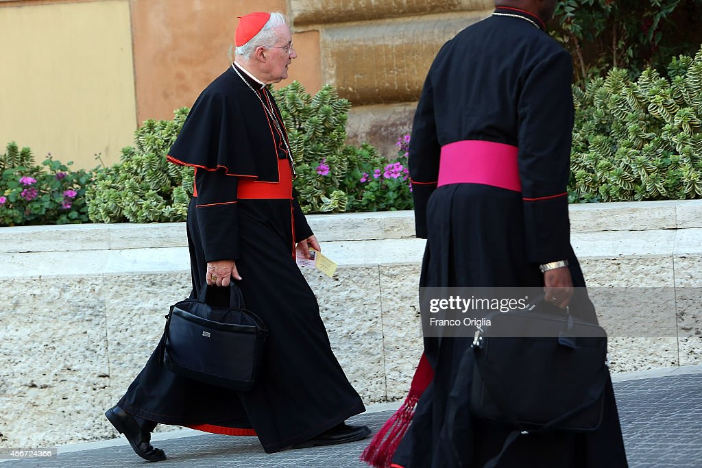 Cardinal <a gi-track='captionPersonalityLinkClicked' href=/galleries/search?phrase=Marc+Ouellet&family=editorial&specificpeople=3145328 ng-click='$event.stopPropagation()'>Marc Ouellet</a> (L) arrives at the Synod Hall for the opening of the Synod on the themes of family on October 6, 2014 in Vatican City, Vatican. The two week General Assembly will discuss the 'The Pastoral Challenges of the Family in the Context of the Evangelization'.