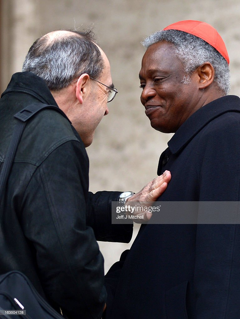 Cardinal <a gi-track='captionPersonalityLinkClicked' href=/galleries/search?phrase=Peter+Turkson&family=editorial&specificpeople=7196090 ng-click='$event.stopPropagation()'>Peter Turkson</a> (R) arrives for the final congregation before cardinals enter the conclave to vote for a new pope, on March 11, 2013 in Vatican City, Vatican. Cardinals are set to enter the papal conclave to elect a successor to Pope Benedict XVI after he became the first pope in 600 years to resign from the role. The conclave is scheduled to start on March 12 inside the Sistine Chapel and will be attended by 115 cardinals as they vote to select the 266th Pope of the Catholic Church.