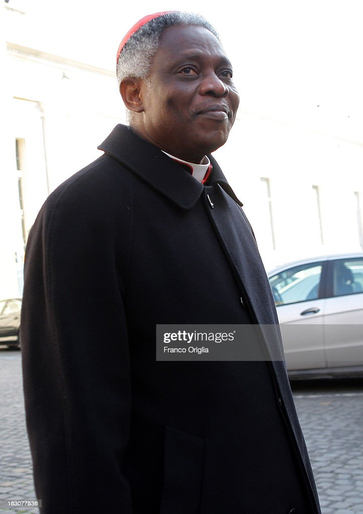 Cardinal <a gi-track='captionPersonalityLinkClicked' href=/galleries/search?phrase=Peter+Turkson&family=editorial&specificpeople=7196090 ng-click='$event.stopPropagation()'>Peter Turkson</a> of Ghana arrives at the Paul VI hall for the opening of the Cardinals' Congregations on March 4, 2013 in Vatican City, Vatican. The congregations of cardinals will continue until all cardinal electors have arrived in Rome, whereupon the College will decide on the start-date of the Conclave to elect a new Pope.