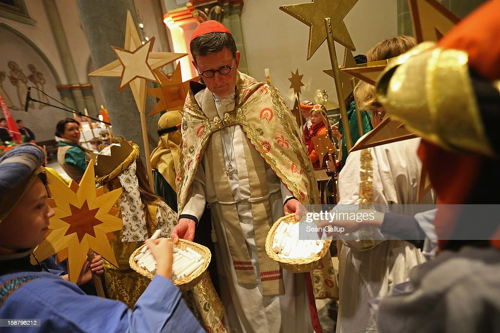 Cardinal Rainer Maria Woelki distributes chalk to children Epiphany carolers, in German called Sternsinger and dressed as the three kings Balthasar, Melchior and Gaspar, attending a religious mass ahead of their annual charity donation collection drive on December 29, 2012 in Berlin, Germany. The children will walk house to house in the days around January 6, singing carols and collecting money for needy children across the globe.