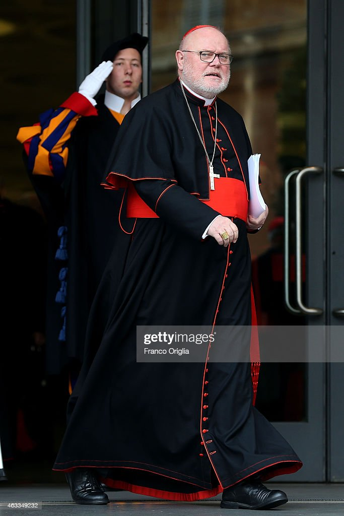 Cardinal <a gi-track='captionPersonalityLinkClicked' href=/galleries/search?phrase=Reinhard+Marx&family=editorial&specificpeople=4687697 ng-click='$event.stopPropagation()'>Reinhard Marx</a> from Munich leaves the Synod Hall at the end of the Extraordinary Consistory for the creation of new cardinals on February 13, 2015 in Vatican City, Vatican. Reform of the Curia, is at the centre of the Extraordinary Consistory which included the 20 prelates who will be created Cardinals on Saturday.