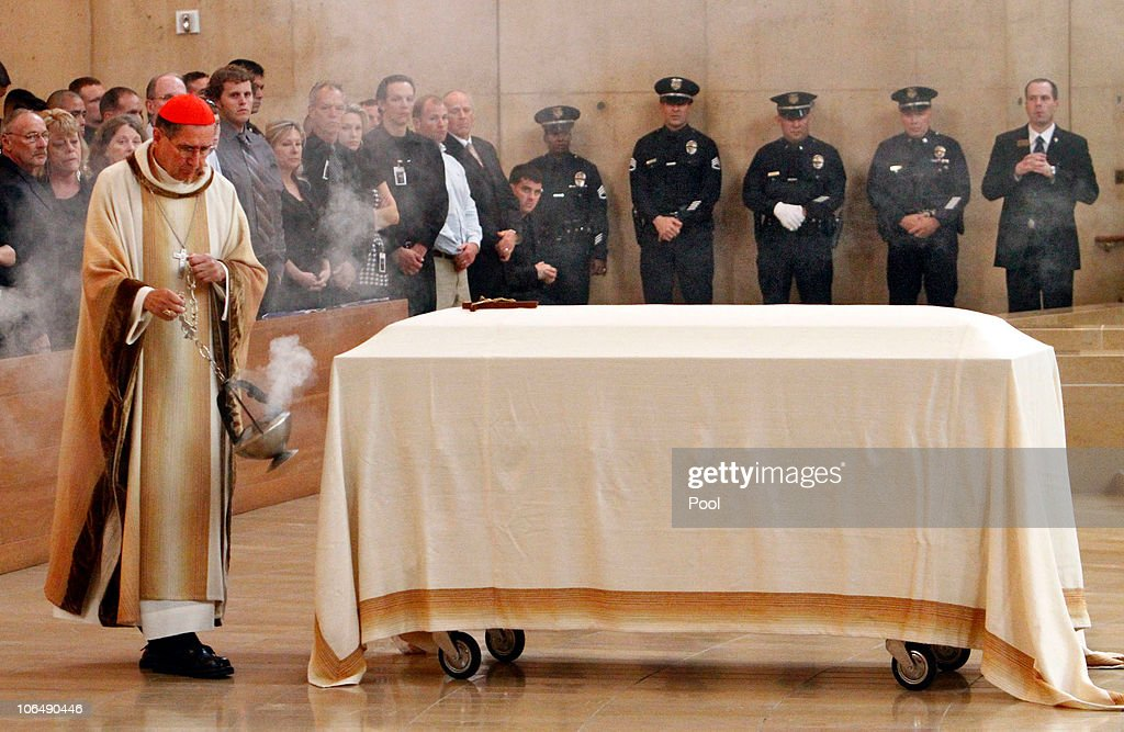 LA Cardinal <a gi-track='captionPersonalityLinkClicked' href=/galleries/search?phrase=Roger+Mahony&family=editorial&specificpeople=664416 ng-click='$event.stopPropagation()'>Roger Mahony</a> blesses the casket of LAPD officer and Marine Corps Reserve Staff Sergeant Joshua Cullins during his funeral at the Cathedral of Our Lady of Angels November 3, 2010 in Los Angeles, California. Cullins was killed by a roadside bomb while on military duty in Afghanistan. The 28 year old served with the 3rd Battalion, 6th Marine Regiment in Marja, in Afghanistan's dangerous Helmand province.