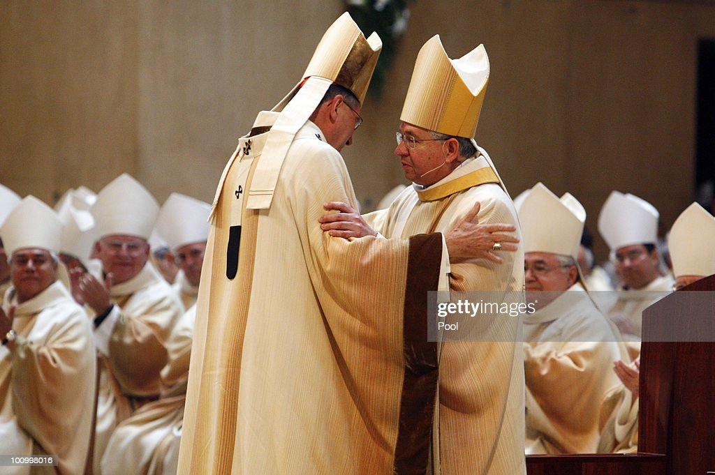 Cardinal <a gi-track='captionPersonalityLinkClicked' href=/galleries/search?phrase=Roger+Mahony&family=editorial&specificpeople=664416 ng-click='$event.stopPropagation()'>Roger Mahony</a> (L) greets Archbishop Jose H. Gomez during a welcoming Mass Mass at the Cathedral of Our Lady of the Angels May 26, 2010 in downtown Los Angeles, California. The Mexican-born Gomez previously served as archbishop of San Antonio, and as an auxiliary bishop in Denver. Gomez becomes the first Hispanic archbishop of the nation's most populous archdiocese where he will work alongside Cardinal <a gi-track='captionPersonalityLinkClicked' href=/galleries/search?phrase=Roger+Mahony&family=editorial&specificpeople=664416 ng-click='$event.stopPropagation()'>Roger Mahony</a> before succeeding him when the cardinal retires in February 2011.