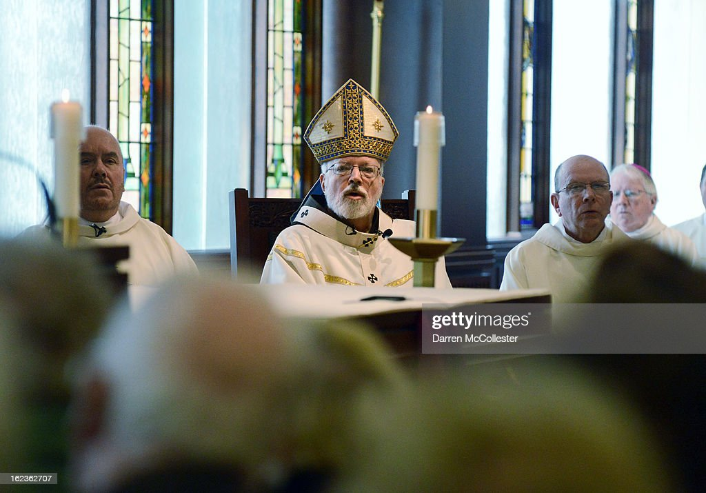 Cardinal Sean O'Malley (2nd L) celebrates Noon Mass at The Chapel Pastoral Center February 22, 2013 in Braintree, Massachusetts. Cardinal OMalley, the Roman Catholic archbishop of Boston, Massachusetts, will be traveling to the Vatican to take part in the next papal conclave to pick the next pope after the resignation of Pope Benedict XVI.