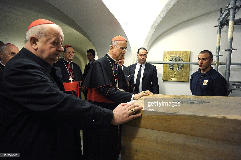 Cardinal Stanislaw Dziwisz of Cracow and Vatican State Secretary Cardinal Tarcisio Bertone carry the coffin of Pope John Paul II exhumed ahead of his...