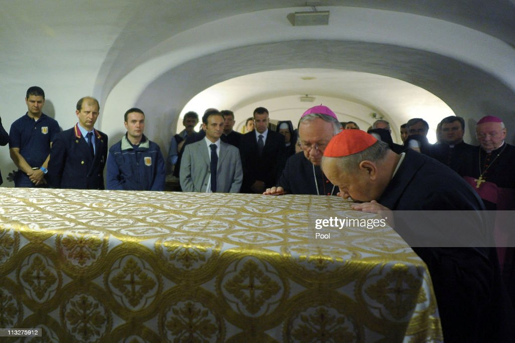 Cardinal Stanislaw Dziwisz of Cracow kisses the coffin of Pope John Paul II exhumed ahead of his beatification at Vatican Basilica on April 29 2011...