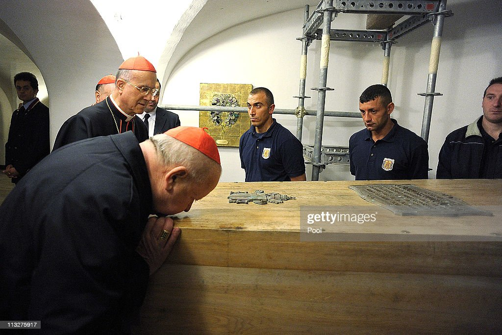 Cardinal Stanislaw Dziwisz of Cracow kisses the coffin of Pope John Paul II exhumed ahead of his beatification as Vatican State Secretary Cardinal...