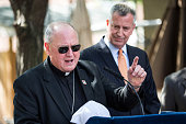 Cardinal Timothy Dolan and New York City Mayor Bill de Blasio announce a partnership between New York City and the Roman Catholic church to provide...