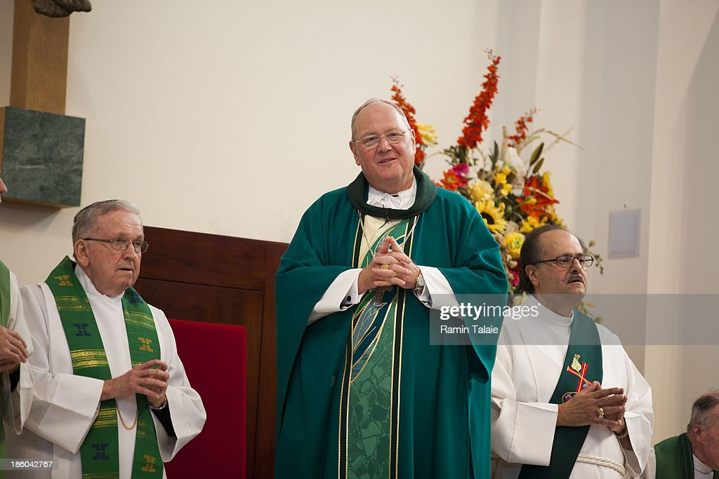 Cardinal Timothy Dolan celebrates a Mass of Remembrance marking the first anniversary of Hurricane Sandy at Our Lady Star of the Sea church on October 27, 2013 in Staten Island borough of New York City. Hurricane Sandy made landfall on October 29, 2012 near Brigantine, New Jersey and affected 24 states from Florida to Maine and cost the country an estimated $65 billion.