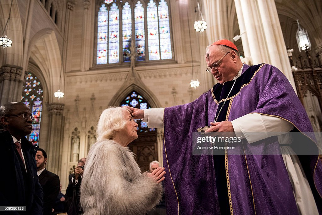 Cardinal Timothy Dolan distributes ashes on Ash Wednesday at St. Patrick's Cathedral on February 10, 2016 in New York City. The day marks the start of the lent for Catholics world wide.