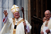 Cardinal Timothy Dolan greets attendees in front of St Patricks Cathedral during the annual Easter Parade April 5 2015 in New York City The parade...
