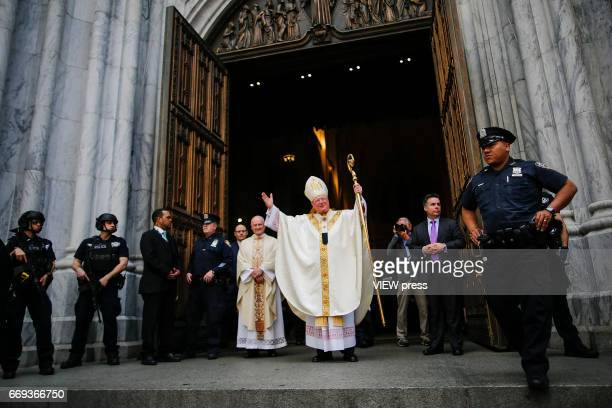 Cardinal Timothy Dolan greets people outside St Patrick'u2019s Cathedral during the Annual Easter parade on April 16 2017 in New York City The Easter...