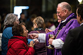 Cardinal Timothy Dolan serves communion during Mass on Ash Wednesday at St Patrick's Catherdral on February 18 2015 in New York City Ash Wednesday is...