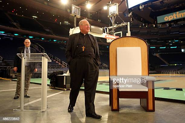 Cardinal Timothy Dolan unveils the chair Pope Francis will use during Mass at Madison Square Garden later this month on September 2 2015 in New York...