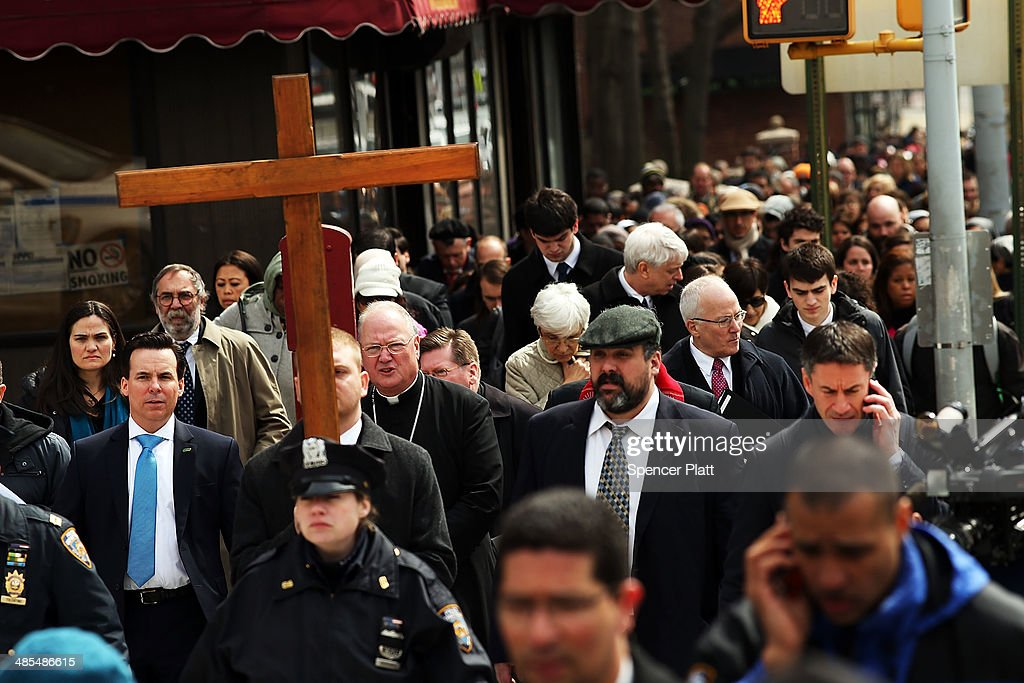 Cardinal Timothy Dolan walks behind the cross during the start of the Way of the Cross procession over the Brooklyn Bridge on April 18, 2014 in the Brooklyn borough of New York City. The Way of the Cross is a traditional Catholic procession recalling the suffering and death of Jesus Christ and often includes Gospel readings, choral music and readings at stations along the way. This is 19th anniversary of the procession across the iconic bridge.
