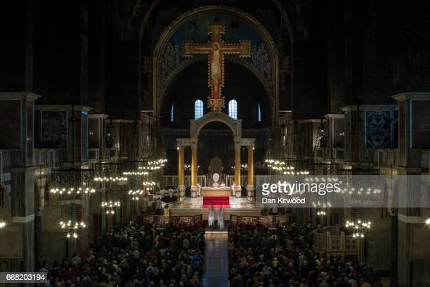 Cardinal Vincent Nichols conducts Maundy Thursday Mass at Westminster Cathedral on April 13 2017 in London England Maundy Thursday marks the start of...