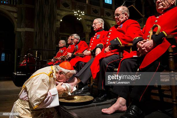 Cardinal Vincent Nichols leader of the Roman Catholic community in England and Wales hold a Maundy Thursday Mass and washes and kisses the feet of a...