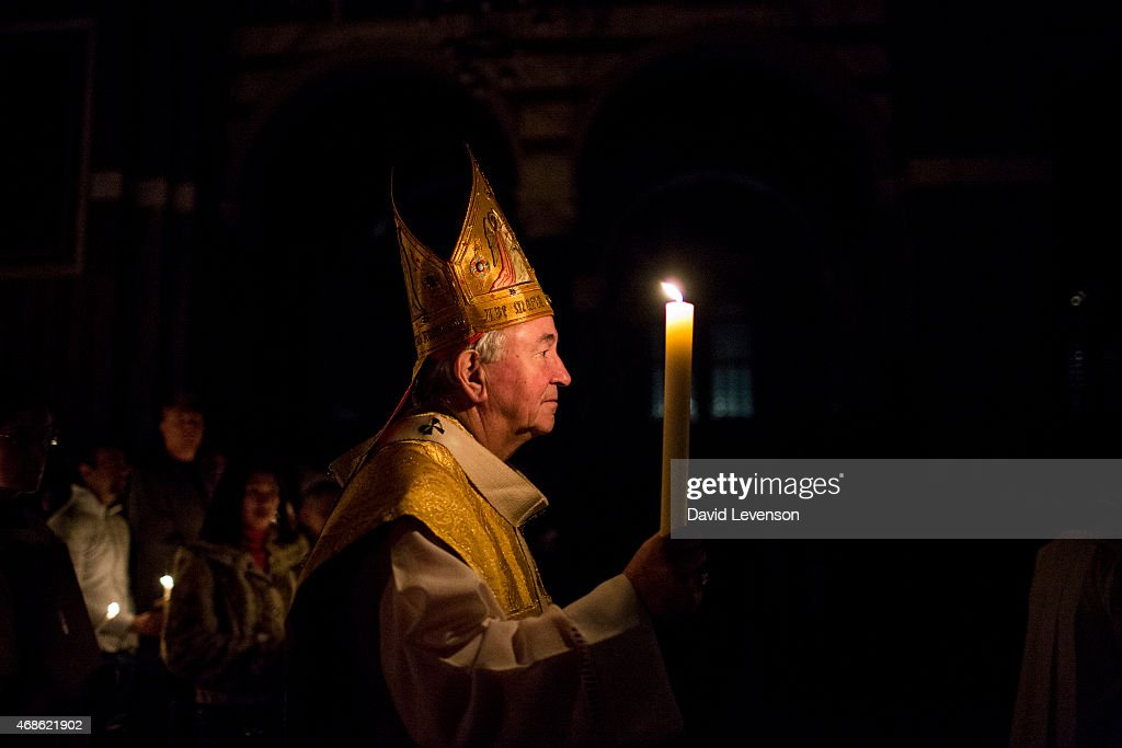 Cardinal Vincent Nichols leads The Easter Vigil service on the evening of Holy Saturday at Westminster Cathedral on April 4 2015 in London England...