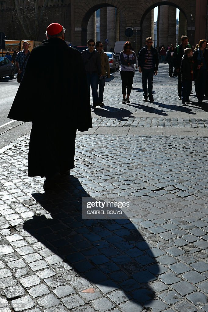 A cardinal walks near the Vatican on 19 February, 2013. Pope Benedict XVI began a week-long spiritual retreat out of the public eye on Monday ahead of his resignation on February 28, with the field of candidates to succeed him still wide open.
