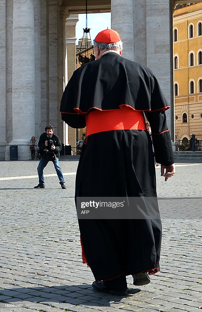 A cardinal walks on St Peter's square during a break of a meeting of a conclave to elect a new pope on March 4, 2013 at the Vatican. The Vatican meetings will set the date for the start of the conclave this month and help identify candidates among the cardinals to be the next leader of the world's 1.2 billion Catholics.