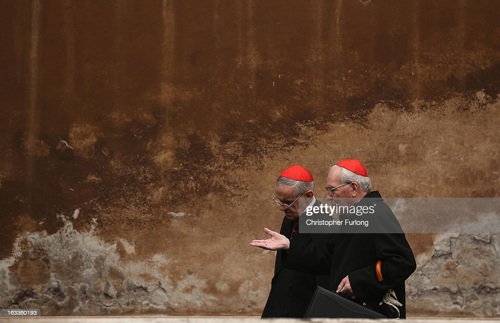 Cardinals chat as they arrive for their eighth congregation at the Paul VI Hall inside the Vatican on March 8, 2013 in Vatican City, Vatican. Cardinals are set to enter the conclave to elect a successor to Pope Benedict XVI after he became the first pope in 600 years to resign from the role. The conclave is scheduled to start on March 12 inside the Sistine Chapel and will be attended by 115 cardinals as they vote to select the 266th Pope of the Catholic Church.