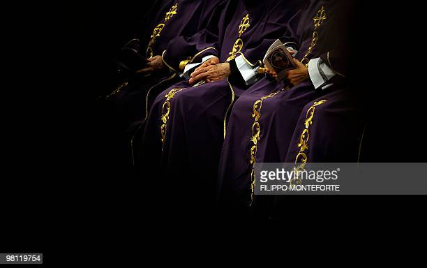 Cardinals follow Pope Benedict XVI celebrating the mass in memory of John Paul II on the 5th anniversary of his death in Saint Peter's Basilica at...