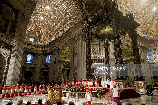 Cardinals kiss the Holy Cross during the Celebration of the Lord's Passion held by Pope Francis at St Peter's Basilica on March 25 2016 in Vatican...