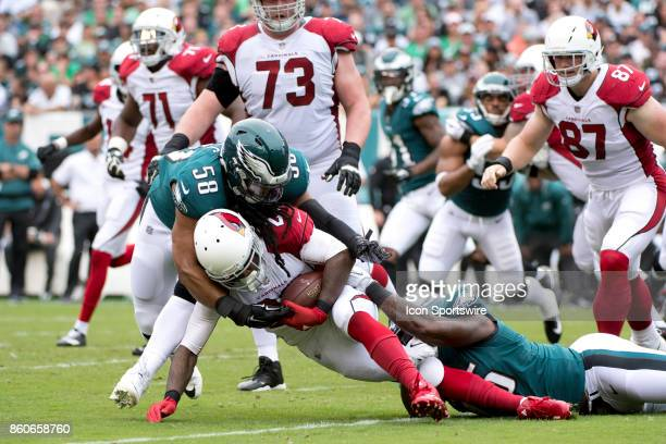 Cardinals RB Chris Johnson is brought down by Eagles LB Jordan Hicks and Eagles DE Vinny Curry in the first half during the game between the Arizona...