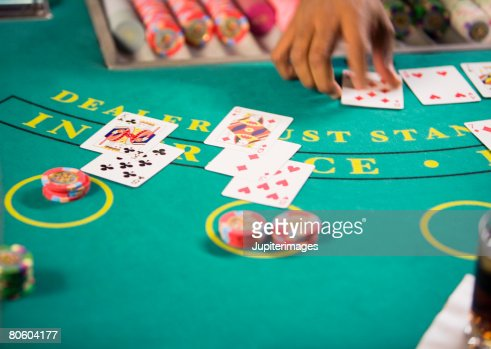 Cards and chips on gambling table : Stock Photo