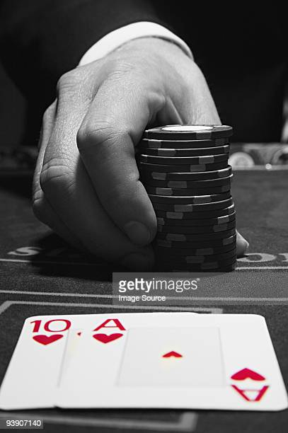 Cards and hand with gambling chips