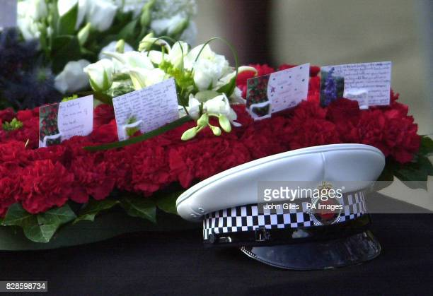 Cards from the wife and children of Stephen Oakes are placed behind his Police hat on his coffin ahead of his funeral at Manchester Cathedral A...