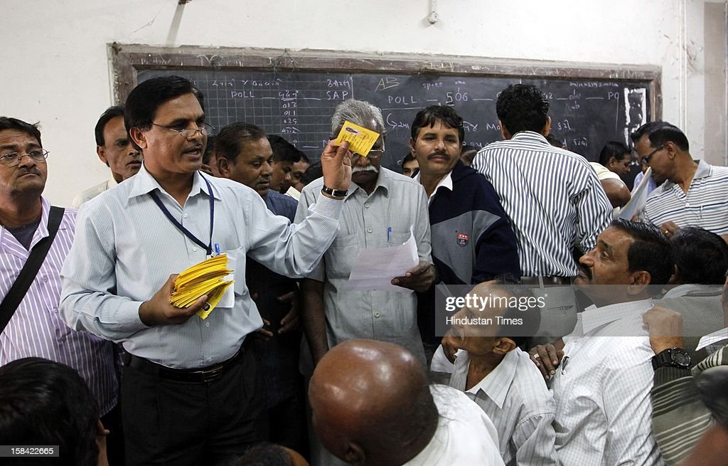 ID cards of the Election staffs are being distributed for the last phase of Assembly poll of Gujarat on December 16, 2012 in Ahmedabad, India.