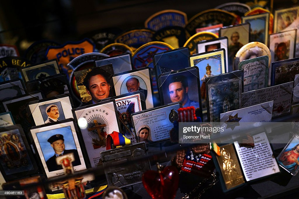 Cards, patches and mementos of those killed at Ground Zero are are viewed during a preview of the National September 11 Memorial Museum on May 14, 2014 in New York City. The long awaited museum will open to the public on May 21 following a six-day dedication period for 9/11 families, survivors, first responders, workers, and local city residents. For the dedication period the doors to the museum will be open for 24-hours a day from May 15 through May 20. On Thursday President Barack Obama and the first lady will attend the dedication ceremony for the opening of the museum. While the construction of the museum has often been fraught with politics and controversy, the exhibitions and displays seek to pay tribute to the 2,983 victims of the 9/11 attacks and the 1993 bombing while also educating the public on the September 11 attacks on the World Trade Center, the Pentagon and in Pennsylvania.