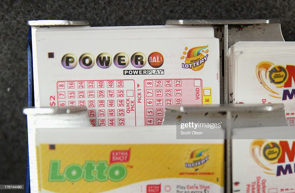 Cards used to select Powerball and other lottery numbers sit on the counter at a 7Eleven store on August 7 2013 in Chicago Illinois The Powerball...