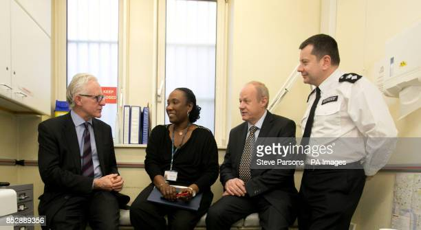 Care and Support Minister Norman Lamb and Minister for Policing and Criminal Justice Damian Green speak with nurse Oulaye Tommy and Chief...
