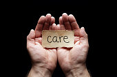 Care with the protection of cupped hands, concept for love, help, assistance, security and caring