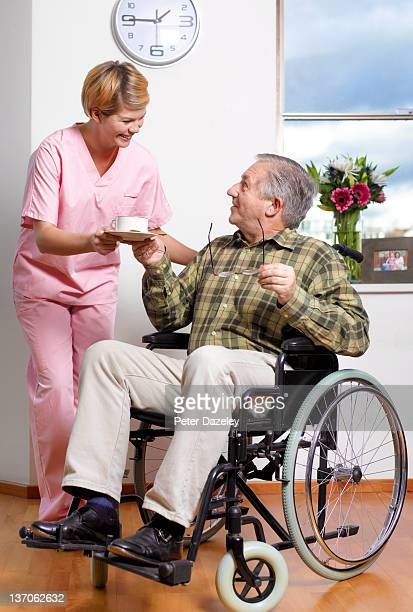 Care worker with resident in care home