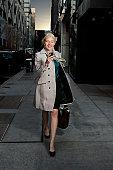 Career woman walking and texting