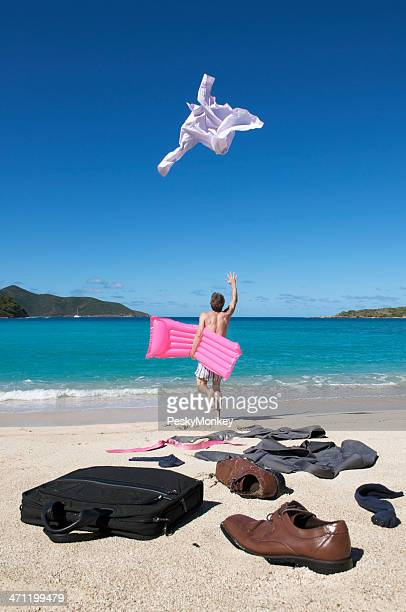 Carefree Businessman Runs to Vacation Throwing Suit on the Beach