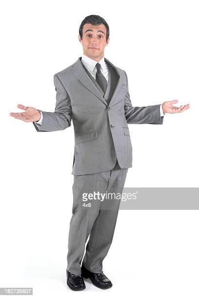 Carefree businessman shrugging