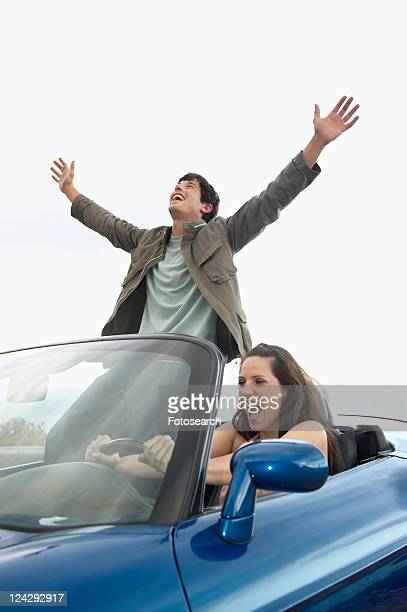 Carefree Couple Driving Convertible
