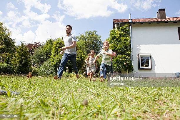 Carefree family running in garden