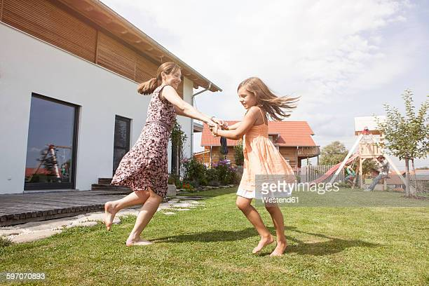 Carefree mother and daughter in garden